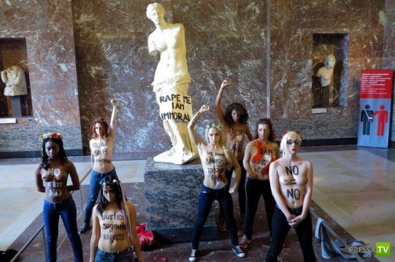 Активистки FEMEN оккупировали статую Венеры Милосской в  Лувре (12 фото)