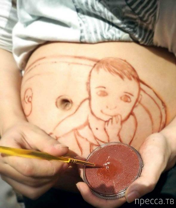 Беременная художница из Китая рисует портреты будущего сына на животе (9 фото)