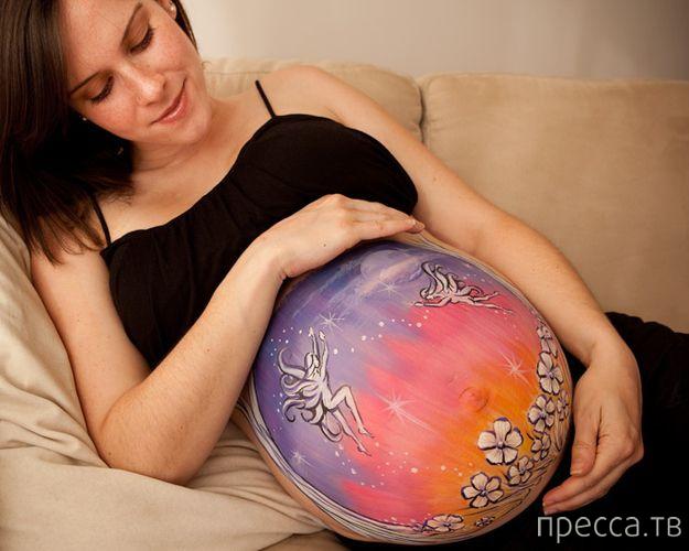 Креативные раскраски на животах будущих мам (22 фото)