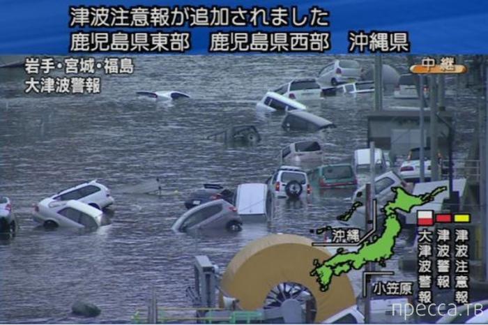 Странный призрак во время цунами в Японии (фото + видео)