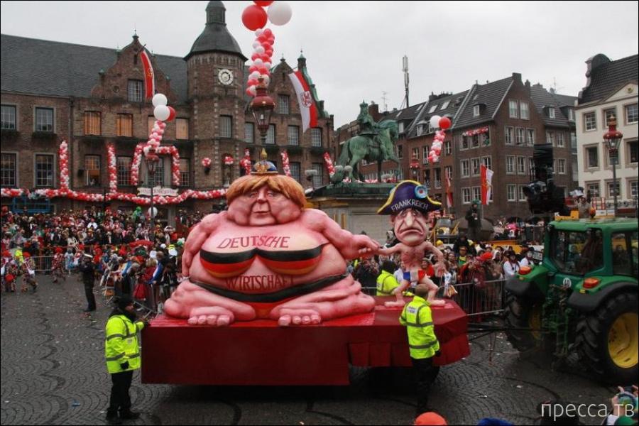 Карикатурные скульптуры известных мировых политиков на карнавале в Дюссельдорфе, Германия (6 фото)